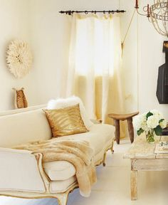 love the white sofa w/classical lines