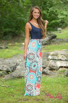 This vibrant tank maxi will have tons of people complimenting your style! It features a gorgeous multicolor skirt with aqua, mint, orange, lime green, coral, black, and white with a navy bodice. It's easy to dress it for the weather - you can wear as it arrives in the summer or add a cardigan for cooler days!