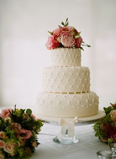 Pretty white wedding cake with florals captured by Christina Brosnan | onefabday.com
