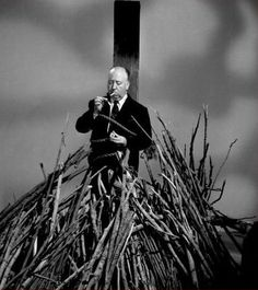 Promotional portrait of Britishborn American film and television director Alfred Hitchcock as he lights a cigarette while tied to a stake above a. Psychological Thrillers, Photo, Film Director, Alfred Hitchcock, Movies, Image, Hitchcock, Cinema, Pictures