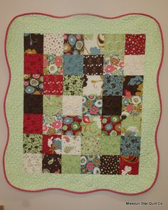 Charm square quilt This soft scalloped border adds sooo much!