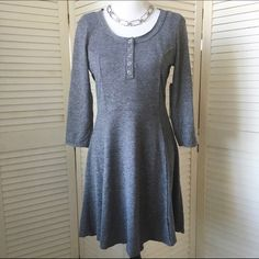 HP Feminine grey skater dress w/ Henley neck Super cute and comfy stretch knit skater dress in grey. Nice mid weight lends a little structure. Scoop neck with Henley style front. Flattering princess seaming. Cute yoke across shoulders in back. Raw hem. Three quarter length sleeves. Marked Junior L. NWOT; never worn. Almost Famous Dresses Long Sleeve
