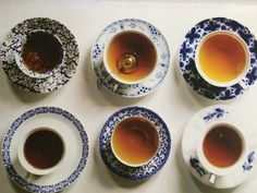 day-and-moonlightdreaming:   Tea cups. / Tea, Coffee, and Books