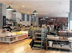 Mixture of everything. Deli counter. Wooden shelves. Baskets. Buckets......