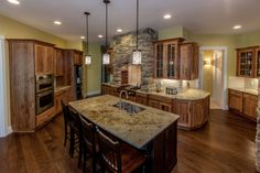 Kitchen with granite counters and lots of cabinets.