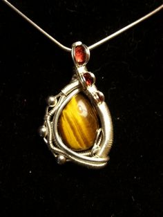 Visit our shop to view more and make purchases! https://www.etsy.com/shop/EasyWindFamily/ https://www.etsy.com/listing/255426692/tigers-eye-and-garnet-wire-wrapped?ref=shop_home_active_9
