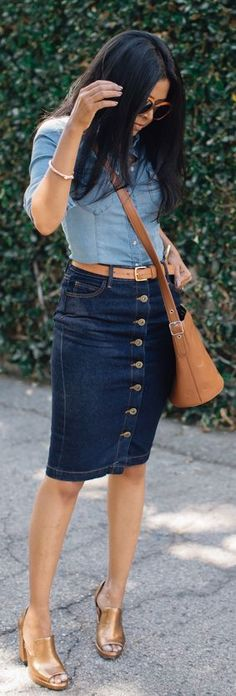 bc09e476013ca Dark denim jean skirt paired with a chambray top and gold accessories makes  for chic denim