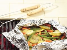 Grilled Garden Vegetable Medley Packs: 2 medium Yukon gold potatoes, cut into 1/8-inch slices   1 1/2 cups baby-cut carrots   4 ounces green beans   2 tablespoons butter or margarine, melted   1/2 teaspoon salt   1/4 teaspoon dried oregano leaves   Cover and grill packet 4 to 6 inches from medium heat 20 to 25 minutes, turning packet over after 10 minutes, until vegetables are tender.