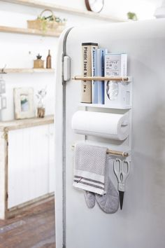 Tosca Magnetic Kitchen Organization Rack in White - Material: Steel/Wood - Product Size: L 3.5 x W 11.4 x H 14.2 inch Please allow 5-7 business days to ship out and receive tracking. Yamazaki brings t