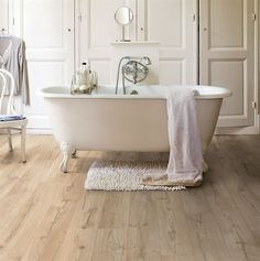 Browse the Impressive Ultra Classic Beige Oak Laminate Flooring by Quickstep at Leader Floors. Laminate Flooring Bathroom, Cheap Laminate Flooring, Waterproof Laminate Flooring, Wood Laminate, Wooden Flooring, Vinyl Flooring, Click Flooring, White Flooring, Garage Flooring