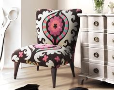 i am in LOVE with this chair!  upholstered with suzani fabric, from Graham and Green