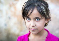 Kurdistan girl with green eyes, Iraq   by Eric Lafforgue