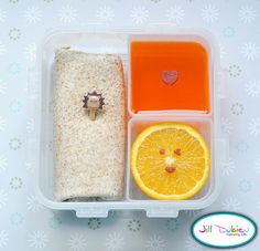 Here's another bento for her afternoon nutrition break. I made a wrap on a whole wheat tortilla filled with ham and cheese. It's held together with a cute little lion pick. A sliced orange with a cute fruit leather face and a container of jello with a fruit leather heart. Kirsten really loves jello so I've been making some ahead of time to put in her lunch. I package of jello will fill 4 of these trays and then I have them ready to go for her lunch.    from meet the dubiens blog