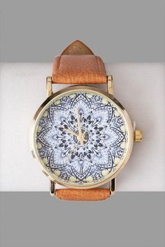 """//Find+your+zen+with+the+Sri+Lanka+Printed+Watch.+This+faux+leather+watch+features+an+abstract+lotus+flower+on+the+dial.++<br><br> - .75""""+band+width<br> - 1.5""""+diameter+(face)+<br> - Battery+operated<br> - Twist+crown+to+set<br> - Imported<br> #accessories #watches"""