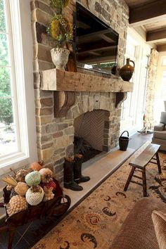A stone fireplace and wood mantle add a charming touch to this living room. The post A stone fireplace and wood mantle add a charming touch to this living room. appeared first on Decoration. Rustic Fireplaces, Farmhouse Fireplace, Home Fireplace, Fireplace Remodel, Fireplace Design, Fireplace Ideas, Rustic Farmhouse, Farmhouse Style, Fireplace Stone