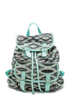 PU Trimmed Tribal Backpack: A refreshingly electrifying canvas backpack featuring a fold-over top with drawstring closure and adjustable faux leather shoulder straps. Exterior fold-over pocket and interior zip and patch pocket. Fully lined $28.50