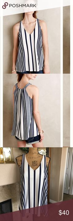 """Puella Swing Tunic NWOT From Anthropologie and new without tags! Fashionable and cool swing tank with navy blue and off white stripes. The bust measures approx 40"""" and the length 28"""". Hand wash and lay flat to dry. Made in the USA. The brand is Puella from Anthropologie. New condition! Anthropologie Tops Tank Tops"""