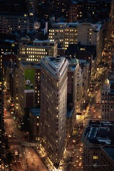 """""""Flatiron Building at Dusk"""" by aboutrc on Flickr - The Fuller Building (aka The Flatiron Building) is an iconic NYC building that's photographed all the time."""