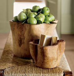 Display bowls  Whether they're filled or left empty, these naturally beautiful hand-carved wood vessels are a gorgeous centrepiece for any living room table. Pottery Barn, $12.99.