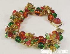 Louis Rousselet Topaz & Emerald Floret Set