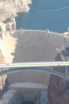 Hoover Dam, once known as Boulder Dam, is a concrete arch-gravity dam in the Black Canyon of the Colorado River, on the border between Arizona and Nevada about 40km from Vegas. It was constructed between 1931 and 1936 during the Great Depression under Franklin Roosevelt. Its construction was the result of a massive effort involving thousands of workers, and cost over one hundred lives. In the foreground you can see the new Hoover Dam Bypass bridge which opened in 2012.