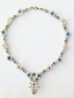 """Necklace """"les fleurs"""" from Sabine Lippert's pattern with swarovski crystals."""