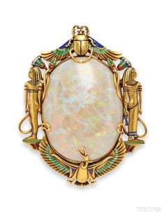 Egyptian Revival 14kt Gold, Opal, and Enamel Brooch, Marcus & Co., the opal framed by ancient Egyptian motifs with enamel accents.