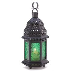 """Green Glass Moroccan Lantern by Furniture Creations. $6.95. 4-1/2"""" x 3-3/4"""" x 10-1/4"""" high.. Metal and glass.. Candle not included.. Weight 0.8 lb.. A halo of emerald green casts a serene glow, as intricate cutouts cast a net of starlight into the tranquil dark. An enchanting play of shadow and motion!  Metal and glass. Candle not included. 4 1/2 inches x 3 3/4 inches x 10 1/4 inches high."""