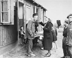 File:A sick Polish survivor in the Hannover-Ahlem concentration camp receives medicine from a German Red Cross worker. Liberated Neuengamme survivor standing on the right has a triangle patch with a top-bar. Red Cross Volunteer, Holocaust Memorial, Camping Set Up, Global Conflict, History Page, World War Ii, Wwii, Mario, Museum