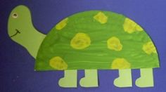 Make this easy turtle by cutting a paper  plate in half, painting green and adding feet and head