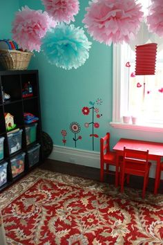 Okay, yeah. I totally love this room. The turquoise walls, which I liked. The black ikea shelves with toys. I love the blue and pink decor on the ceiling and the red accent pieces. OH and the dark floors that I eventually want to put in the house. Could this be Carli  Kates bedroom?