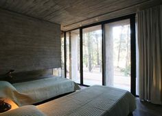 Sleek concrete dwelling in the woods