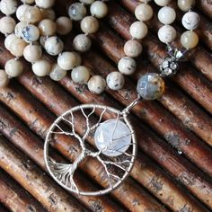 moon behind the tree long necklace.....   MOONSTONE AND AFRICAN OPAL