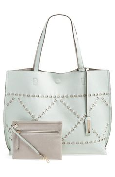 Free shipping and returns on Street Level Reversible Woven Faux Leather Tote at Nordstrom.com. Strips of contrasting faux leather weave a chic diamond pattern across a roomy tote that reverses to match your daily looks. A mini zip pouch clips inside so you can keep your necessities close at hand.