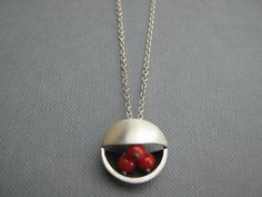 A personal favorite from my Etsy shop https://www.etsy.com/listing/83236886/red-coral-circle-silver-pendant-necklace