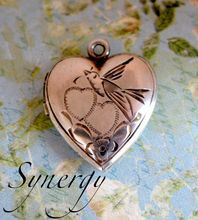sweet sterling love motif locket with bird!