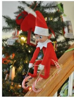Elf riding down the banister