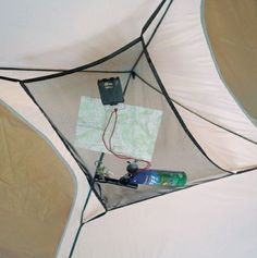 I love this tent organizer -- it hangs from the ceiling of your tent and keeps small gear and gadgets from getting lost. // Find other handy camping gear on this list: http://www.everintransit.com/camping-checklist/
