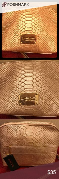 Dome Bebe Wristlet. Rose gold  color & golden hardware dome wristlet it's the perfect size to carry the essentials and more. It's a brand new bag never used before it can also doubles as a make up bag. bebe Bags Clutches & Wristlets