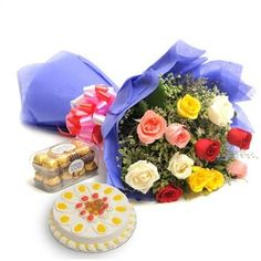 Perfect mix hamper of cakes chocolates with flowers  in India