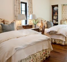 Beautiful comforters - patterned bed skirt.  I like the small desk in between the beds.