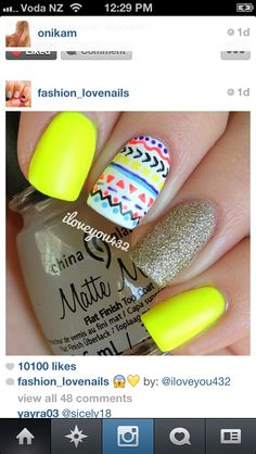 Love the colours used on these nails bright and vibrant simple with just one design on one nail