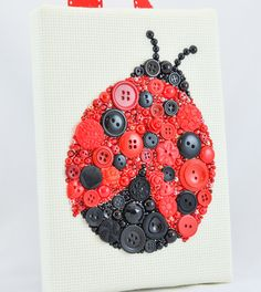 Title: Ladybug  This beautiful piece has been created on a sturdy 5x7 wooden frame wrapped with a high quality cream colored Aida Cloth.  This piece was made using vintage and new buttons, Swarovski crystal rhinestones, and pearl and flower cabochons.  In creation of my art I use vintage buttons and cabochons from my collection. I browse online stores (especially here on Etsy) as well as antique stores and flea markets in search of the most interesting items I can find. I use genuine…