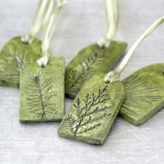 Green plant gift tags $22 EA... MADE WITH CLAY, IMPRESSED TREE FORM (DRAWN IN CLAY) PAINT, RIBBON TO HANG...AS ORNAMENT..OR JEWELRY  ....WHATEVER U THINK UP(: