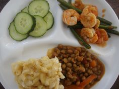 Stove top mac and cheese, shrimp with green beans, stewed pigeon peas and cucumber