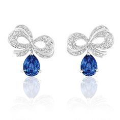 The Dior earrings from the Milieu du Siecle Diamant collection suspend diamond bows and blue sapphires off the ear (POA). Bayco's Monochrome Lotus collection features earrings set with either rubies, sapphires or emeralds (POA). This ring from the Monoch Sapphire And Diamond Earrings, Diamond Bows, Sapphire Jewelry, Diamond Jewelry, Gemstone Jewelry, Blue Sapphire, Dior Jewelry, Jewelry For Her, Jewelery