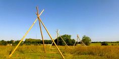 Our naked Tipi poles under the blue skies of France.