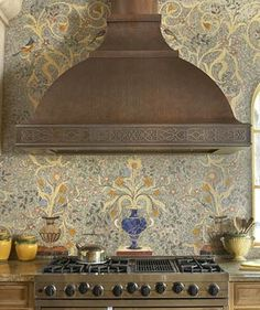 Tilework/mosaic....range hood with trim......love