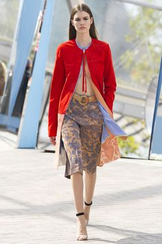 While the majority of exits were fluid, easy skirts and slip dresses, he showed trim coats and tailored shorts that will easily transition well past spring.    - HarpersBAZAAR.com