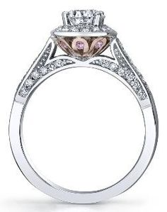 Beautiful detailing in this Maple Leaf Diamond engagement ring with pink sapphires